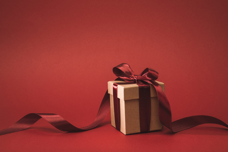Photo for close up view of present decorated with ribbon isolated on red - Royalty Free Image