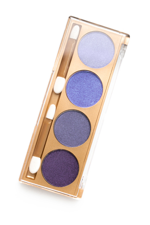 top view of case with different shaded purple cosmetic eye shadows