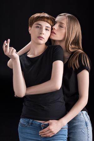 Photo pour Young woman embracing girlfriend - image libre de droit