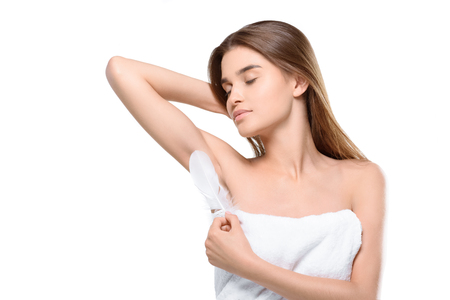 Photo for woman touching armpit with feather - Royalty Free Image