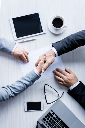 Photo pour top view of business people shaking hands during meeting - image libre de droit
