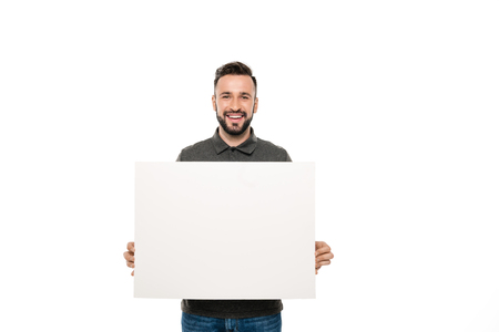 Photo for portrait of smiling man holding blank banner in hands isolated on white - Royalty Free Image