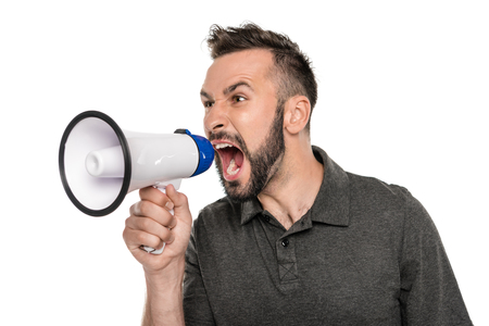 portrait of young man screaming in loudspeaker isolated on white