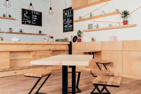 stylish interior of modern cafe with stylish wooden furniture