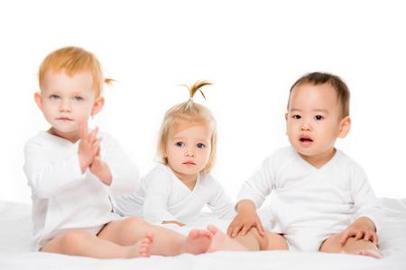Foto de multiethnic toddler asian boy and caucasian girls isolated on white - Imagen libre de derechos