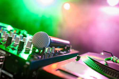 Photo pour close up view of sound mixer with microphone in nightclub with backlit - image libre de droit