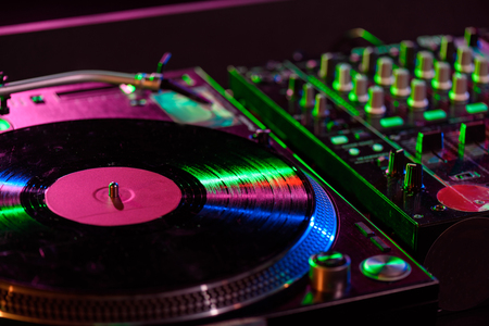 close up view of sound mixer with vinyl in nightclub