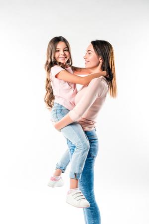 Foto de Mother holding smiling daughter on hands isolated on white - Imagen libre de derechos