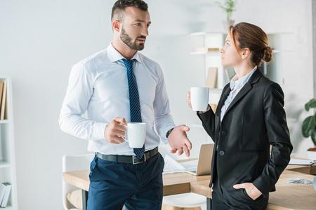 accountants talking in office during coffee break