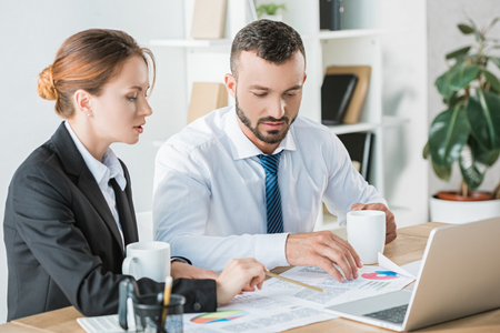 financiers working during coffee break in office