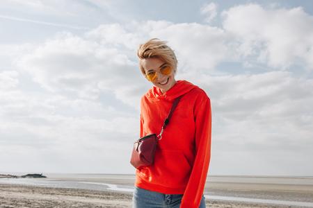 beautiful smiling girl on beach, Saint michaels mount, France