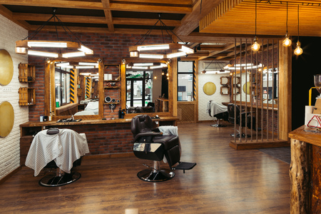 modern stylish empty barber shop interior with mirrors