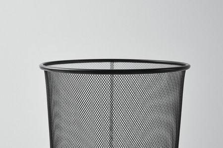 Foto de close-up shot of office trash can isolated on white - Imagen libre de derechos