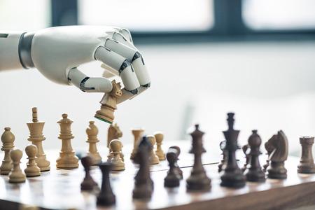 Photo pour close-up view of robot playing chess, selective focus - image libre de droit