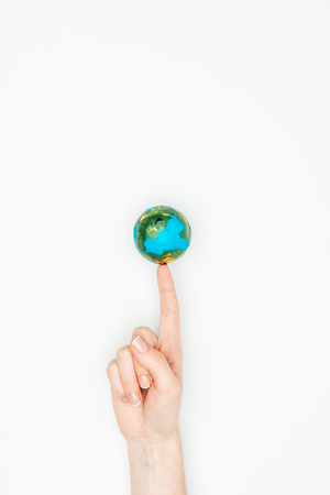 Photo pour cropped image of woman touching earth model isolated on white, earth day concept - image libre de droit
