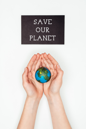 cropped image of woman holding earth model in hands under sign save our planet isolated on white, earth day concept