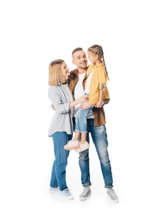Foto de smiling man holding cute daughter with wife standing near by isolated on white - Imagen libre de derechos