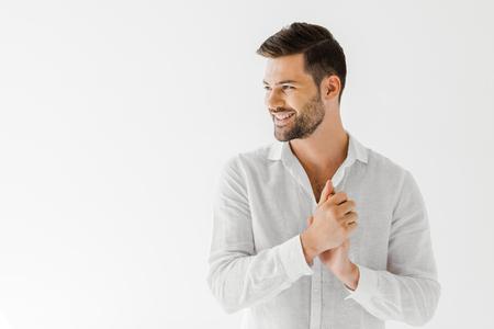 Foto de side view of smiling man in linen white shirt isolated on grey background - Imagen libre de derechos