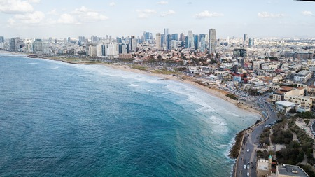 aerial view of city placed on seashore on sunny day, Tel Aviv, Israel