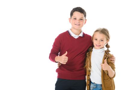 Foto de siblings hugging and showing thumbs up, isolated on white - Imagen libre de derechos