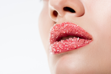 Photo pour Cropped view of woman with sugar on pink lips, isolated on white - image libre de droit