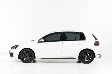 Foto de Side view of one new white automobile on white - Imagen libre de derechos