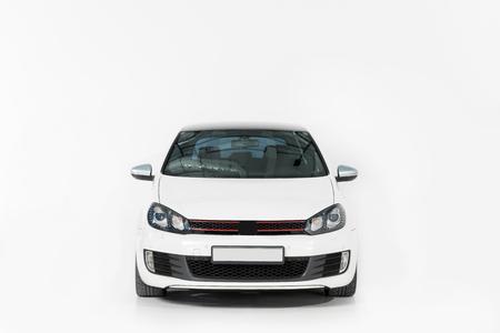Foto de Front view of one new white automobile on white - Imagen libre de derechos