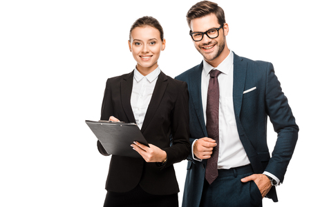 Foto de Happy young business partners with clipboard looking at camera isolated on white background - Imagen libre de derechos