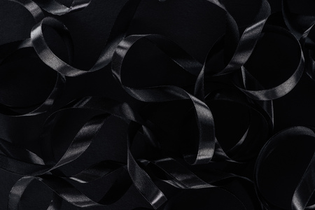 Photo pour top view of black glossy ribbons as background for black friday - image libre de droit
