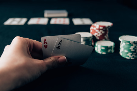 Photo for Woman holding playing cards by casino table - Royalty Free Image