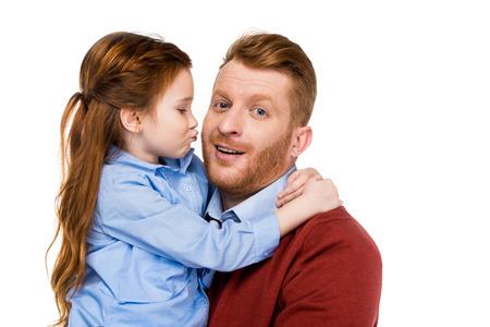 Foto de cute little daughter hugging and kissing happy father isolated on white - Imagen libre de derechos