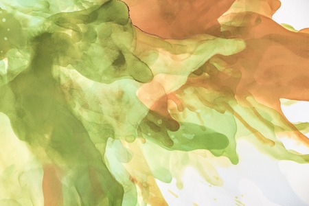 Photo pour Beautiful brown and green splashes of alcohol inks as abstract background - image libre de droit