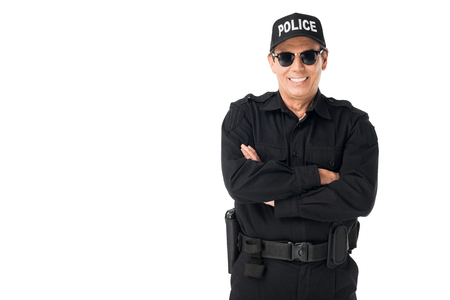 Photo for Smiling policeman wearing uniform with arms folded isolated on white background - Royalty Free Image