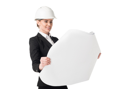 Photo pour Female construction engineer in suit looking at blueprint isolated on white background - image libre de droit