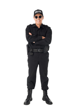 Photo for Smiling policeman with arms folded isolated on white background - Royalty Free Image