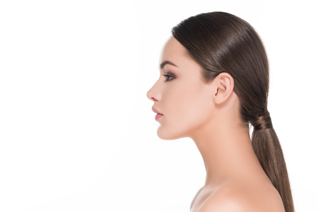 Photo pour side view of beautiful young woman with pony tail isolated on white - image libre de droit