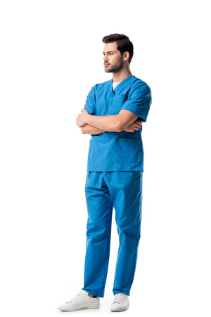 Photo pour Handsome male nurse wearing blue uniform isolated on white - image libre de droit