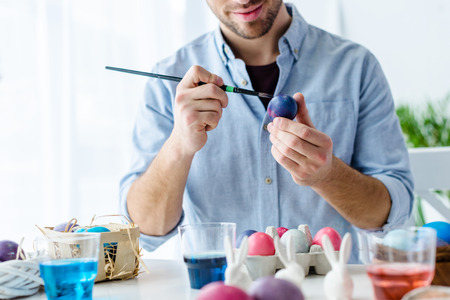 Photo for Close-up view of man painting Easter eggs - Royalty Free Image