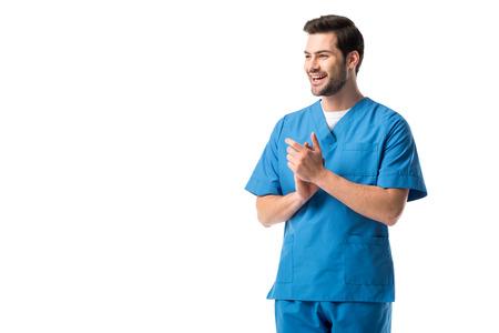 Photo pour Smiling male nurse wearing blue uniform isolated on white - image libre de droit
