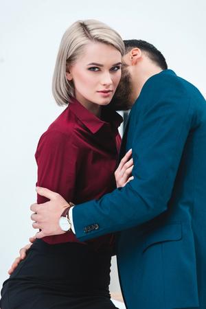 Photo pour seductive young couple of business people kissing and flirting - image libre de droit