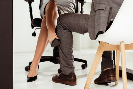 Photo pour cropped shot of businesswoman flirting with colleague at workplace in office - image libre de droit