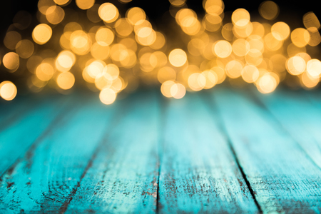 festive bokeh lights on blue wooden surface, christmas background