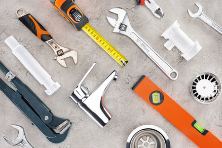 Photo for flat lay with various plumbing tools on concrete surface - Royalty Free Image