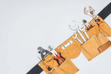Foto de top view of tool kit belt with various repairman instruments isolated on white - Imagen libre de derechos