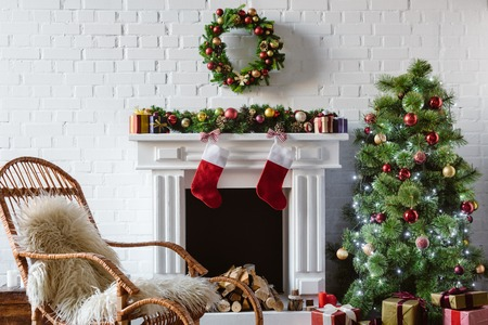 Photo pour living room with fireplace, rocking chair and decorated christmas tree - image libre de droit