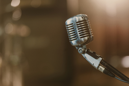 Foto de close-up shot of vintage microphone on blurred background - Imagen libre de derechos