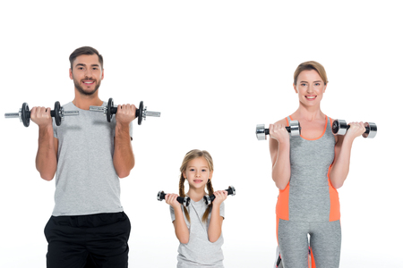 Photo pour portrait of sportive parents and daughter with dumbbells isolated on white - image libre de droit
