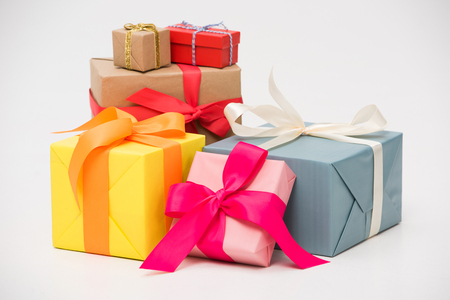 Photo pour close-up view of various colorful gift boxes isolated on white - image libre de droit