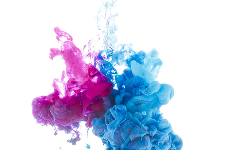 Foto de mixing of blue and pink paint splashes isolated on white - Imagen libre de derechos