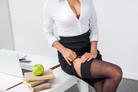 Photo pour young sexy teacher in stockings - image libre de droit